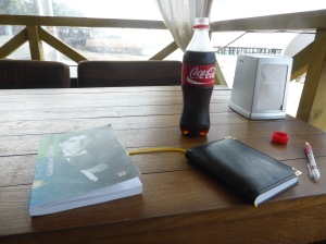 Diary, Coca Cola and a collection of Galaktion Tabidze's poems at a beachside bar.