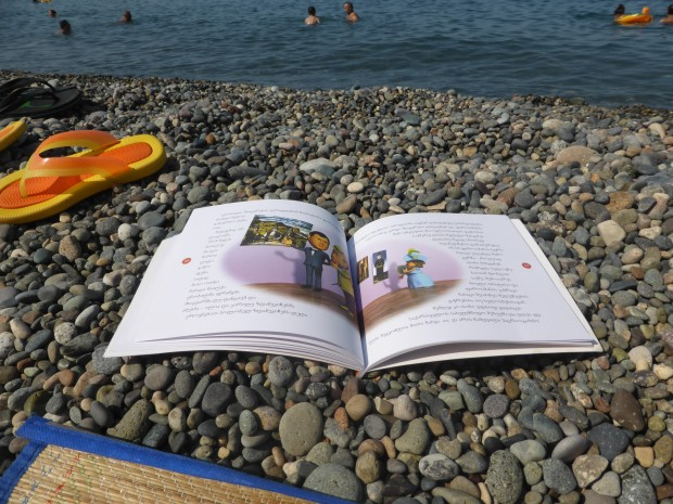Reading about Pirosmani on the beach in Gerogian