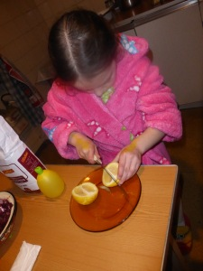 Ana prepares the lemon...yes, that is rather a large knife for a six year old...