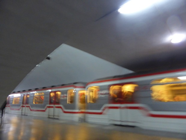 blurred metro carriages arriving at the station