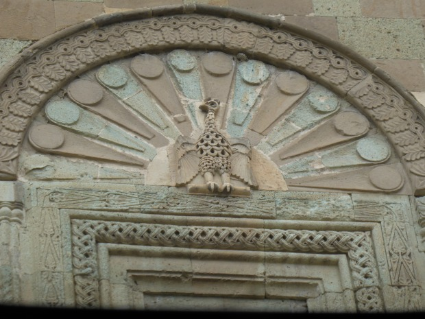 Stone Mason's art, peacock with intricate border at Svetitskhoveli Cathedral in Mtskheta, Georgia