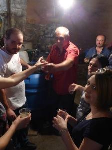 Spartak distributing champagne in his wine cellar