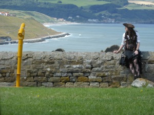 Pirate lass and view over Whitby sands