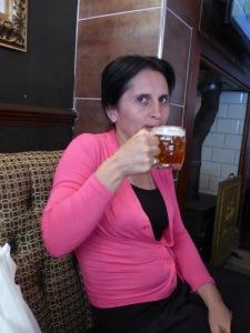 Khato enjoys half a pint of English beer
