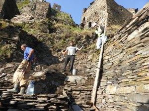 Workers restoring Mutso