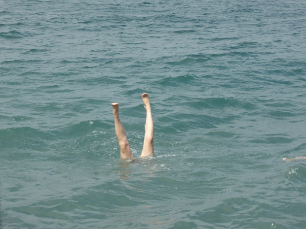 standing on my hands in the sea