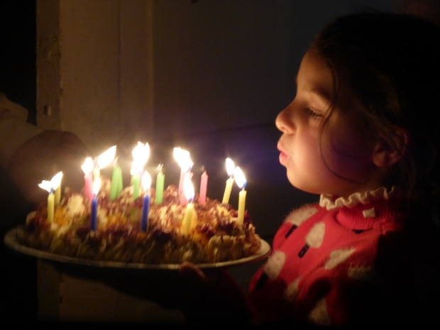 Ana blowing out candles