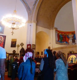 Inside a church service is taking place