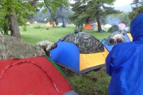 putting up the tents, Giorgi makes a ditch next to the tent t better allow the water to run off